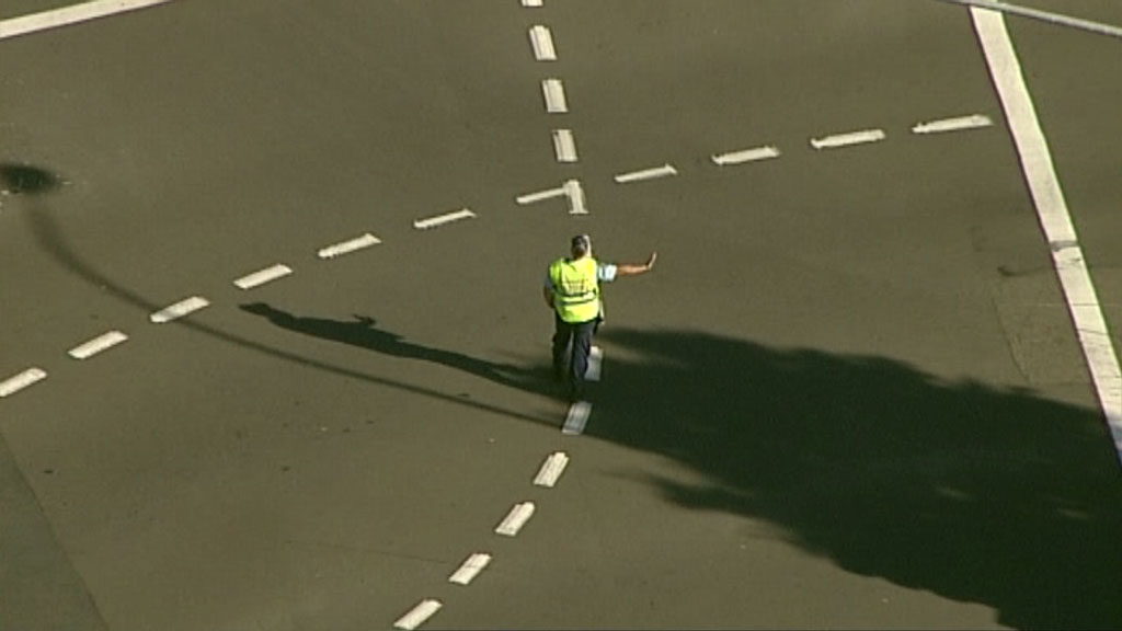 A police officer directs traffic. (9NEWS)