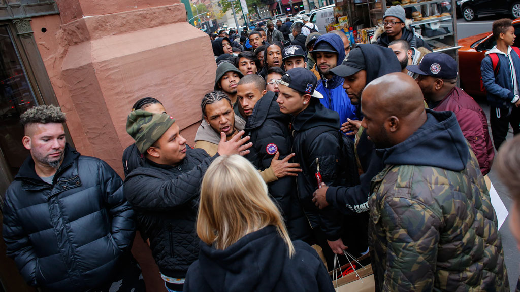 Costumers argue with a Nike Store Worker as they wait in line outside during the Black Friday sells on November 25, 2016, in New York. (AFP)