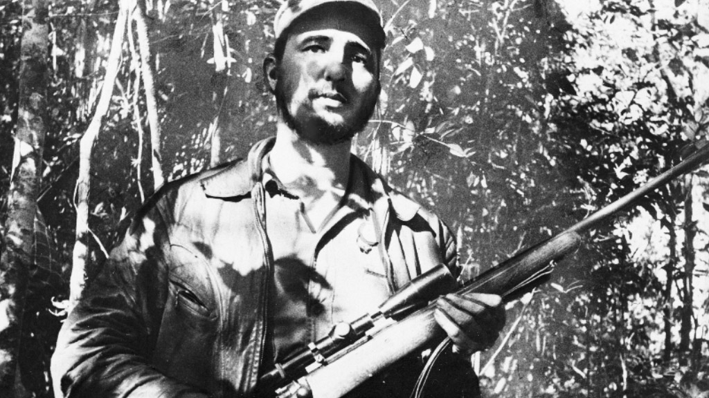 In this Feb. 26, 1957  photo, Cuba's leader Fidel Castro stands in an unknown location in Cuba. (AAP)