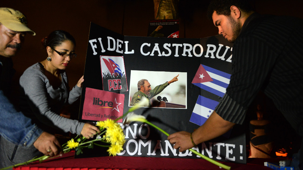 People have converged in Havana to mourn the death of Fidel Castro, while other celebrate the leader's passing in Miami. (AFP)