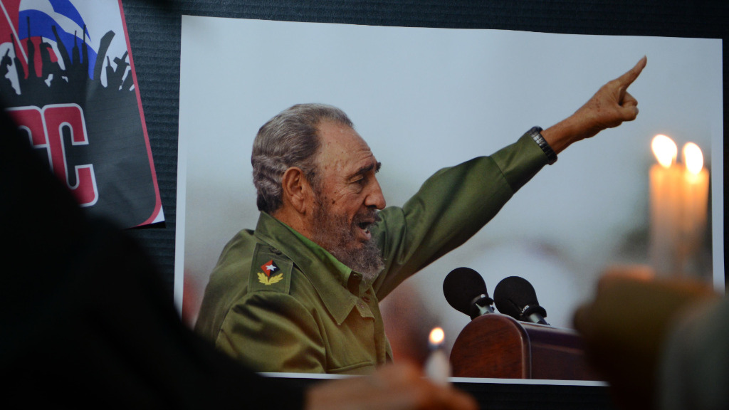 Many held pictures of Castro in remembrance of the leader. (AFP)