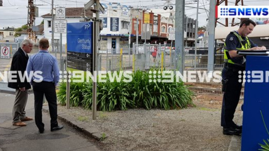 Police have arrested a man after four women were allegedly pushed onto the tracks at Glen Huntly train station. (9NEWS)