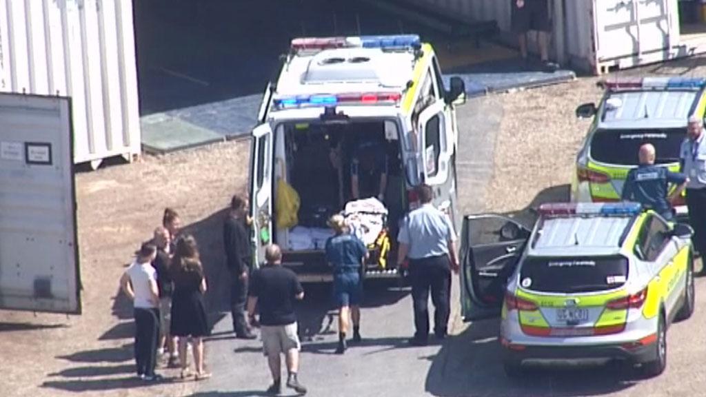 Paramedics wheel the performer into an ambulance. (Choppercam)