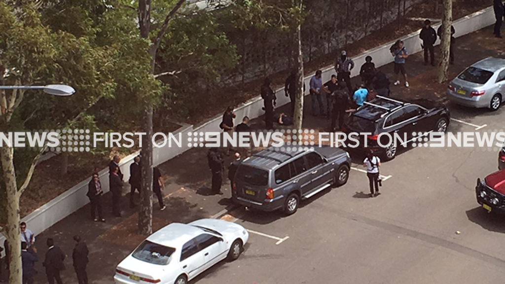 At least two men were detained by police. (Luke Quinlan/Supplied)