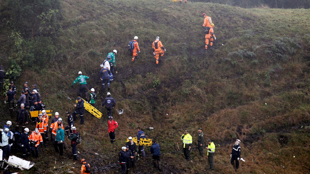Rescue crews work near the wreckage of the crashed plane. (Reuters)