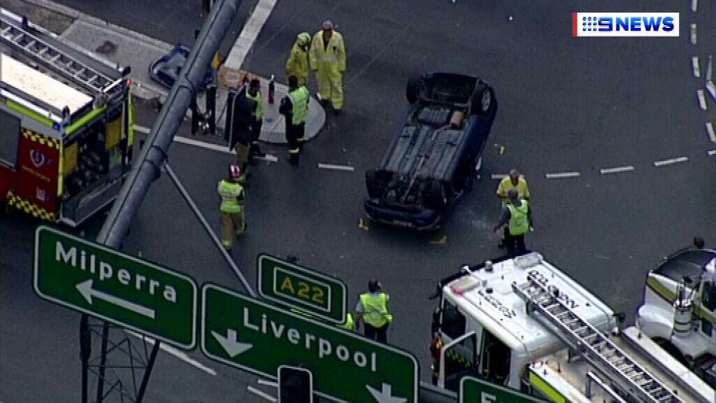 Hume Highway closed in both directions in Sydney's south-west after crash between tanker and car