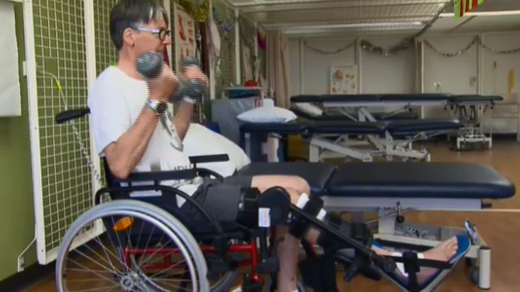 Mr Kaighin continues to use a wheelchair in rehabilitation. (9NEWS)