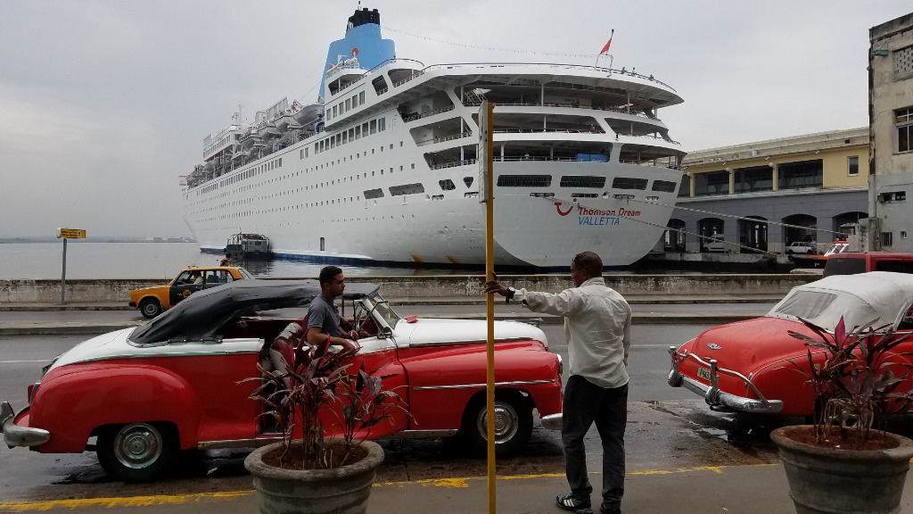 Tourists met by Cuba's iconic vintage cars at the Port of Havana. (9NEWS)