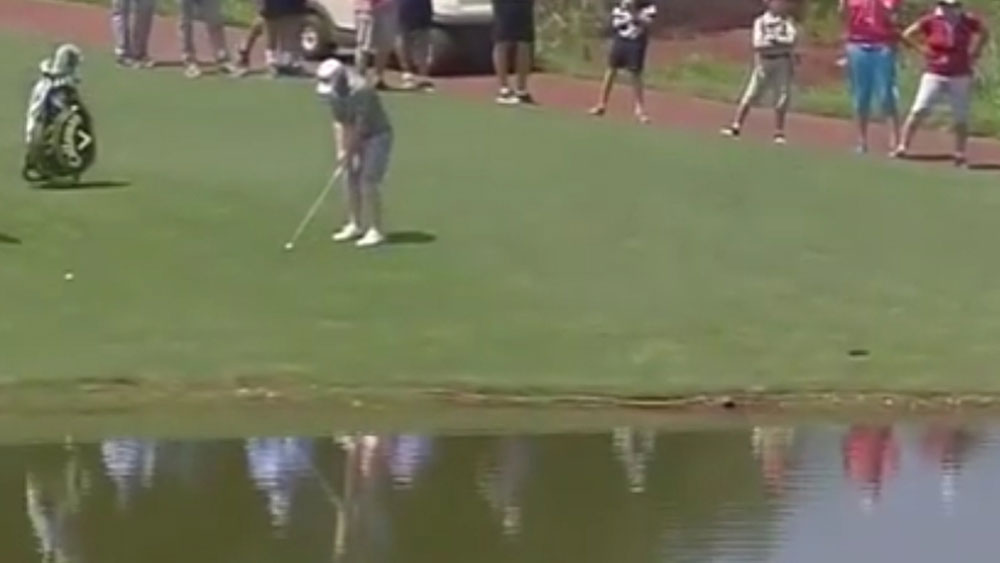 Pro golfer uses the water to his advantage