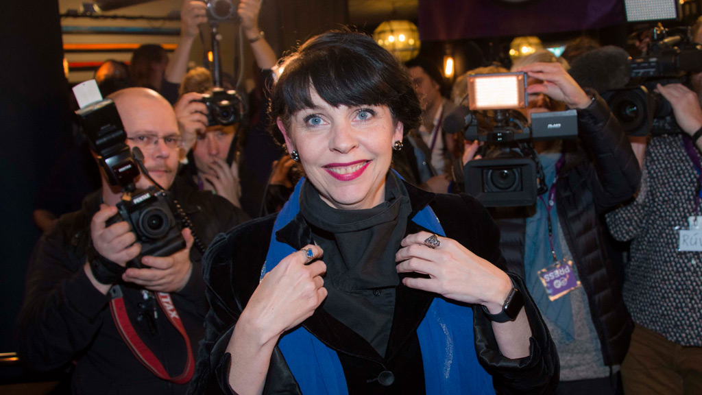 Politician and co-founder of Iceland's Pirate Party Birgitta Jonsdottir is mobbed by media as the election results are announced in Reykjavik, Iceland on October 25, 2016. (AFP)