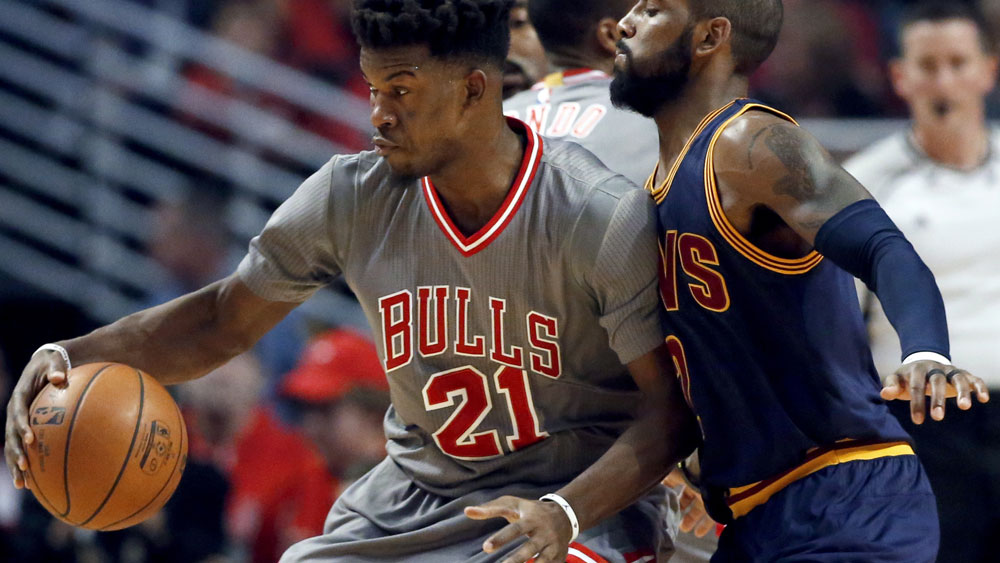 Bulls guard Jimmy Butler takes on Cleveland's Kyrie Irving. (AAP)