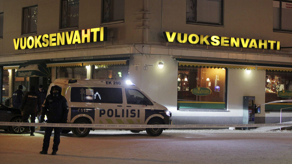 Lone gunman shoots dead official and two journalists outside restaurant in Finland