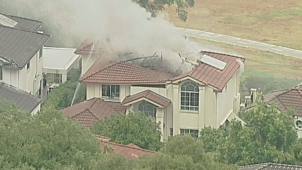 The flames ripped a huge hole in the roof of the house, after it was reportedly struck by lightning. (9NEWS)