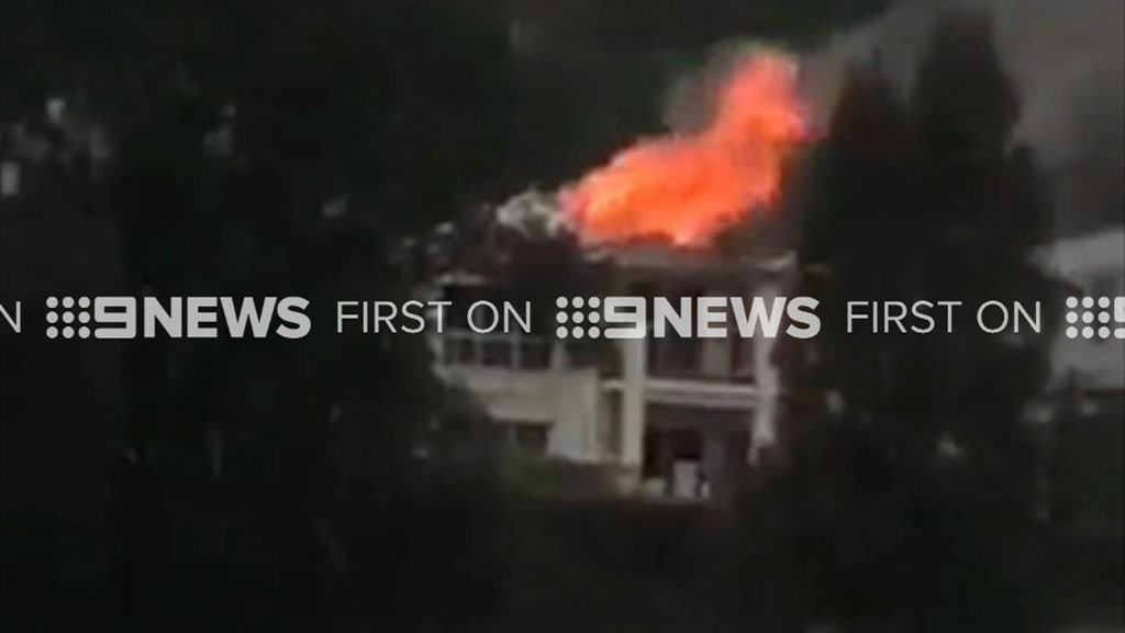 A house in Sydney's Huntley's Cove caught fire during the thunderstorm. (9NEWS)