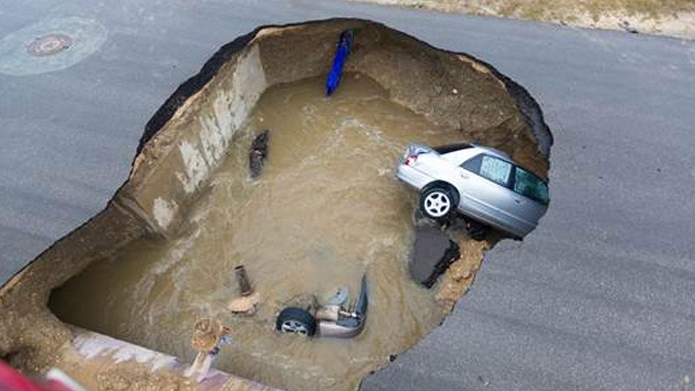 Deputy sheriff killed after car swallowed by sewage sinkhole