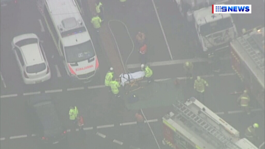 A person is taken away in a stretcher. (9NEWS)
