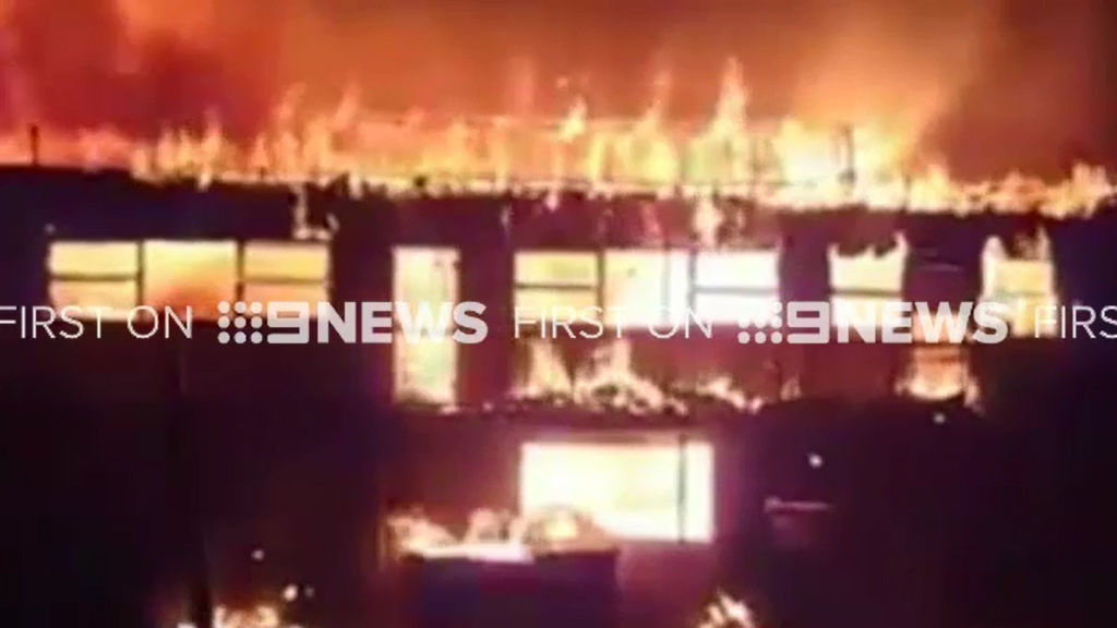 At least six shops have been destroyed in the Farfield fire. (9NEWS)