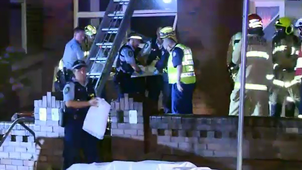 Firefighters were called to a burning Ashfield unit. (9NEWS)