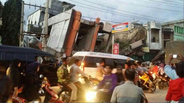 Buildings toppled in devastating Indonesia earthquake