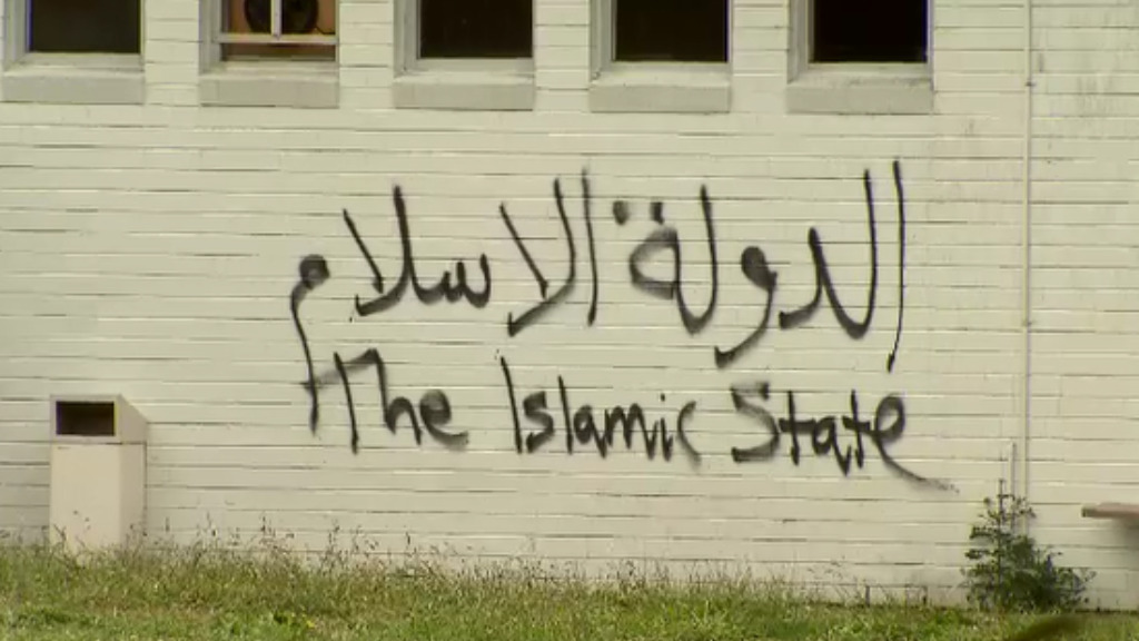 """""""Islamic State"""" graffiti was sprayed on to the side of the building. (9NEWS)"""