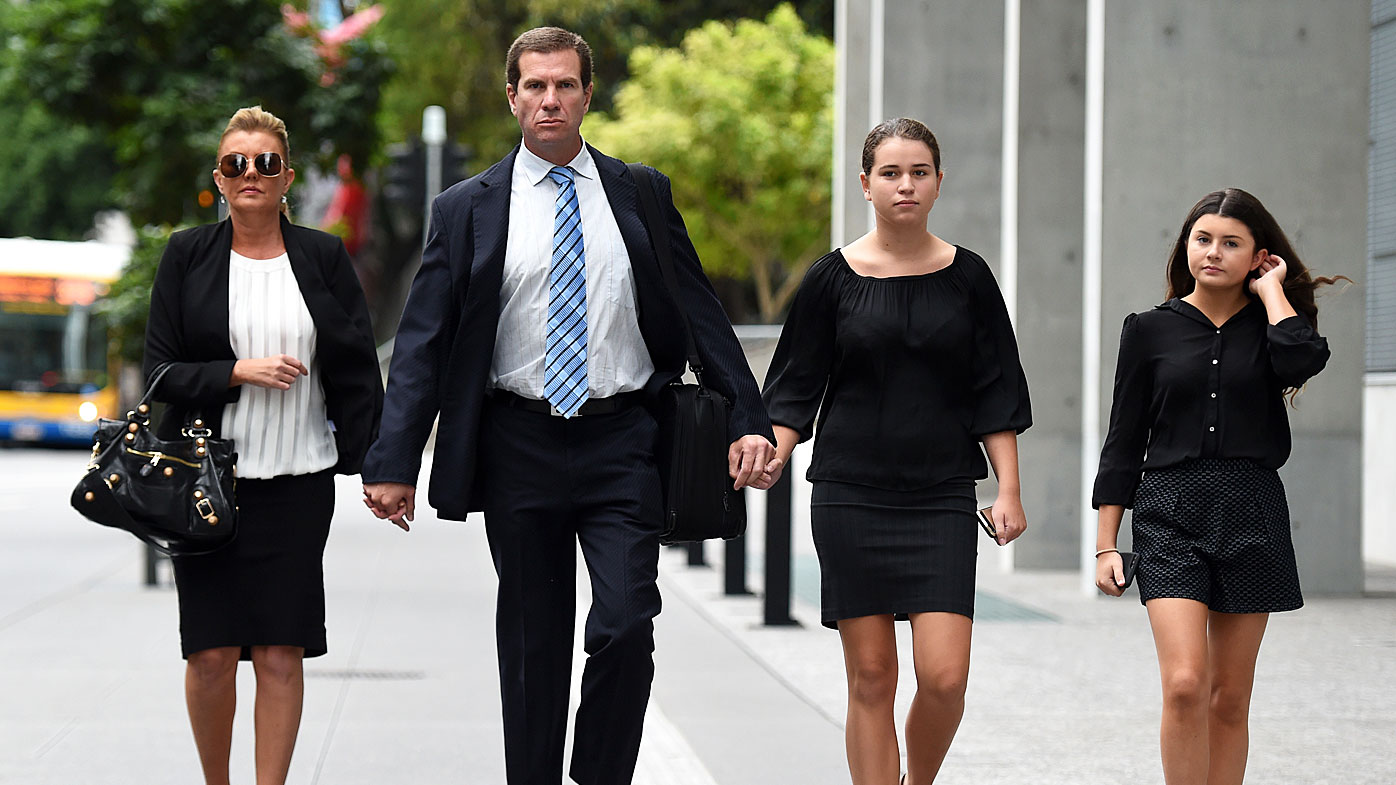 Former Billabong boss Matthew Perrin (2nd left) and his partner Belinda Otton (left), arrive for his trial at the District Court in Brisbane, (AAP)
