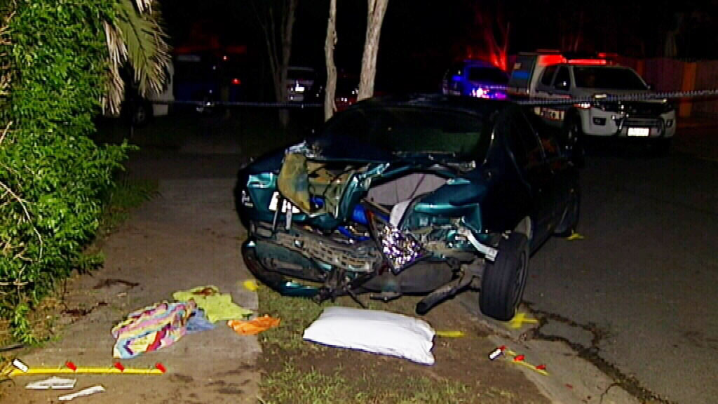 The ute allegedly hit a parked car before hitting Josiah. (9NEWS)