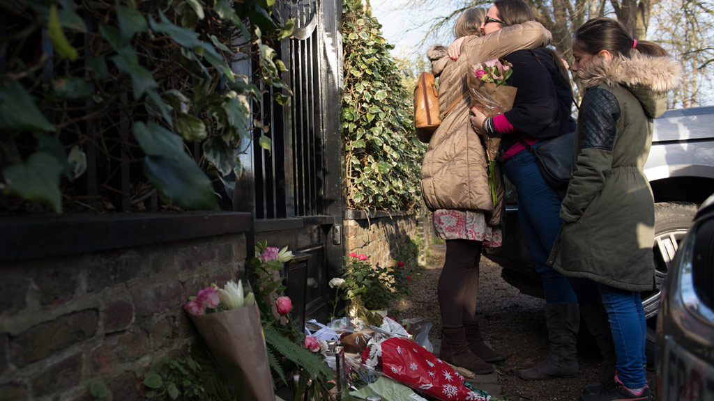 George Michael fans outside his London home, as the pop superstar has died at the age of 53 from suspected heart failure. (AAP)