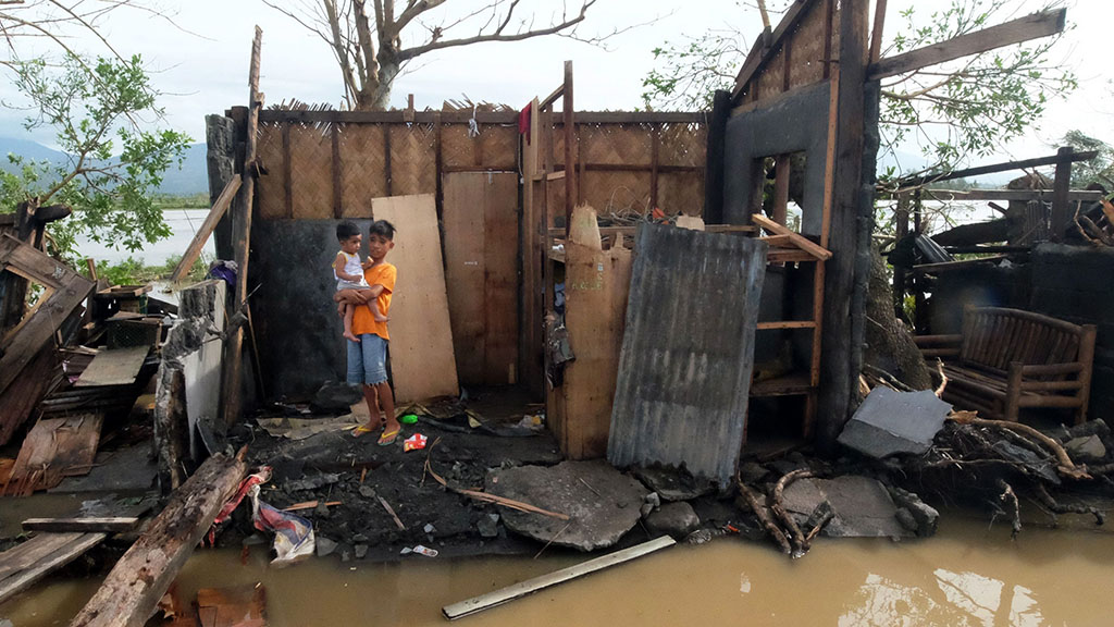 Clean up starts after Christmas typhoon leaves four dead in Philippines