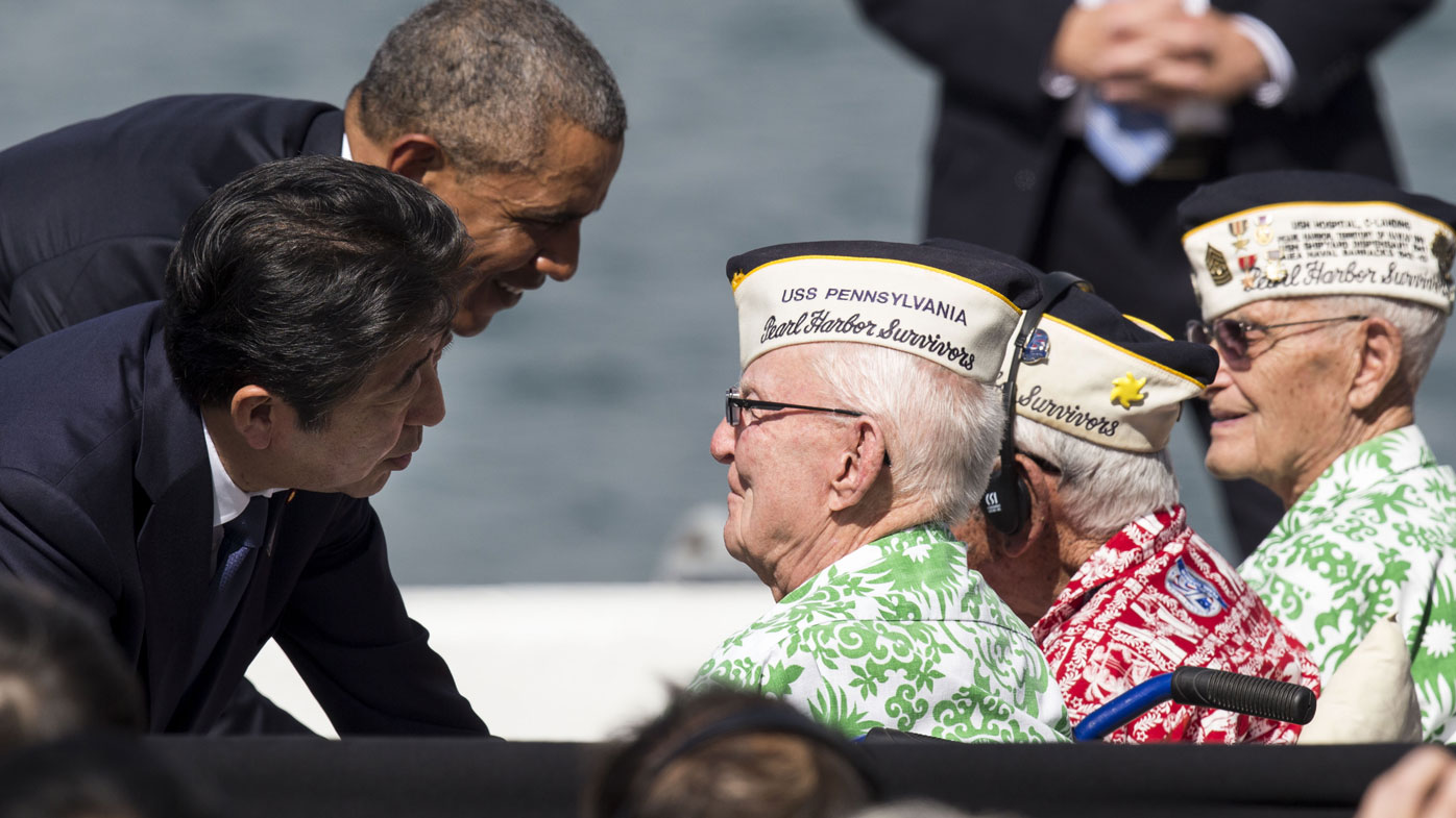 The two leaders greet veterans at Pearl Harbour. (AFP)