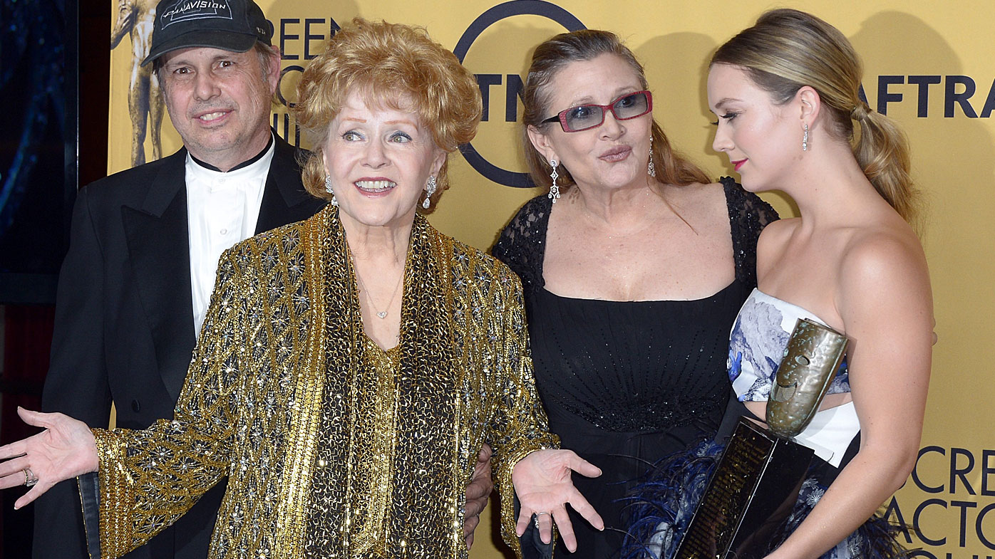 Debbie Reynolds (centre) with her son Todd, daughter Carrie and grand daughter Billie Lourd. (AFP)