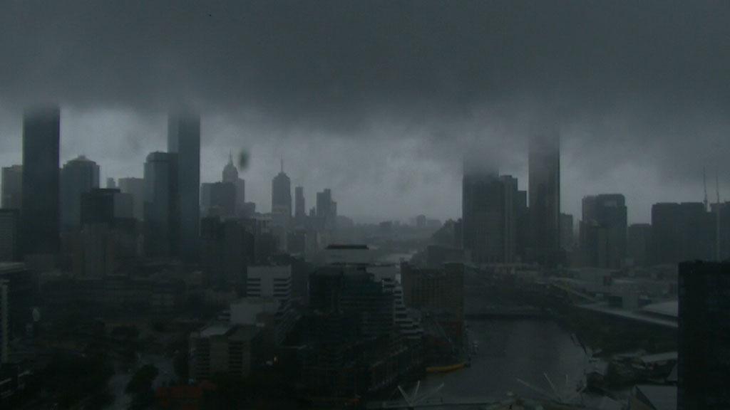Dark skies shrouded the CBD as heavy rain closed in. (9NEWS)