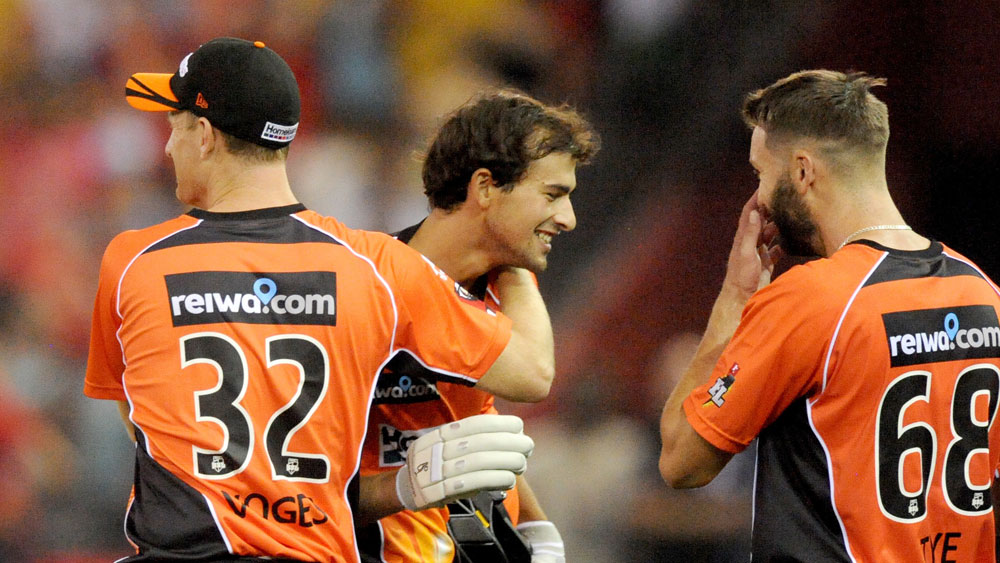 Ashton Agar is mobbed after hitting a six off the last ball to win the match. (AAP)