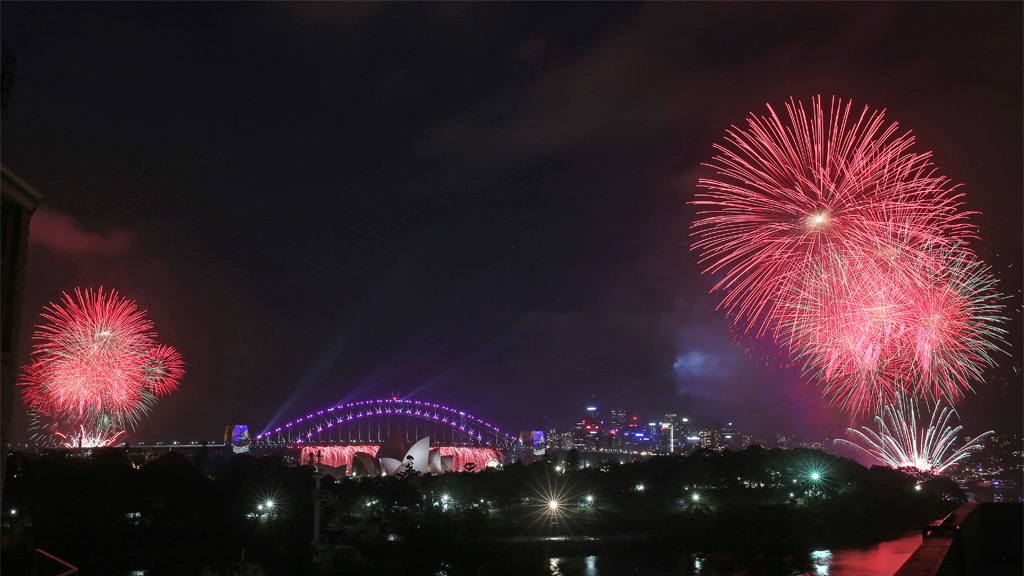 Fireworks explode around the Sydney Opera House and Harbour Bridge as New Year's celebrations get underway in Sydney at 9pm. (AAP)