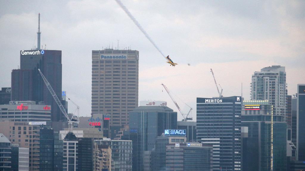 An acrobatic plane maneuvers over Sydney Harbour. (AAP)