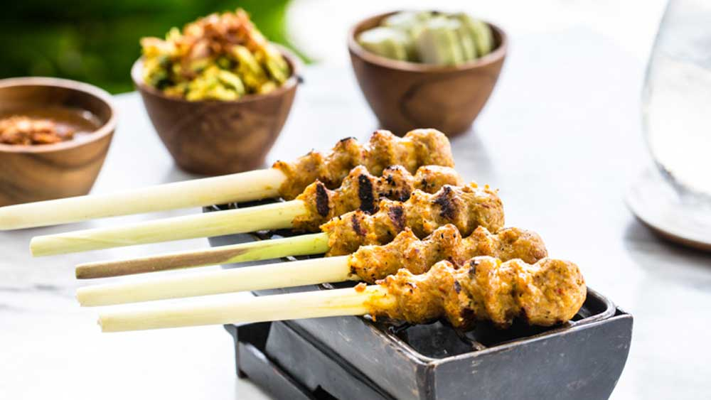 Sate lilit (minced seafood satay grilled on lemongrass skewers)