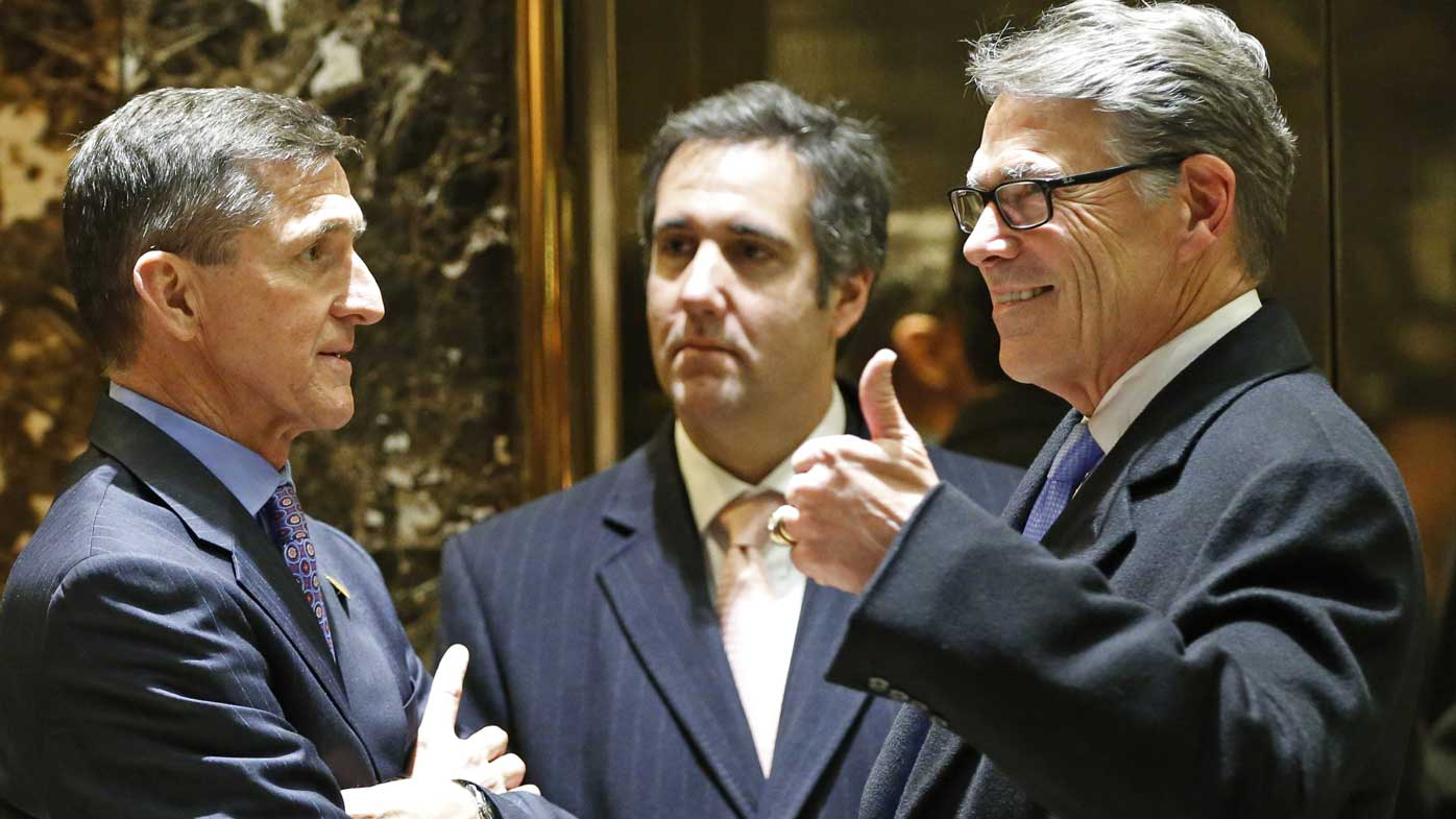 Michael Cohen (centre) chats with General Michael Flynn and former Texas governor Rick Perry. (AP)