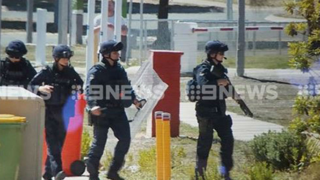 Police at the scene of the riot. (9NEWS)