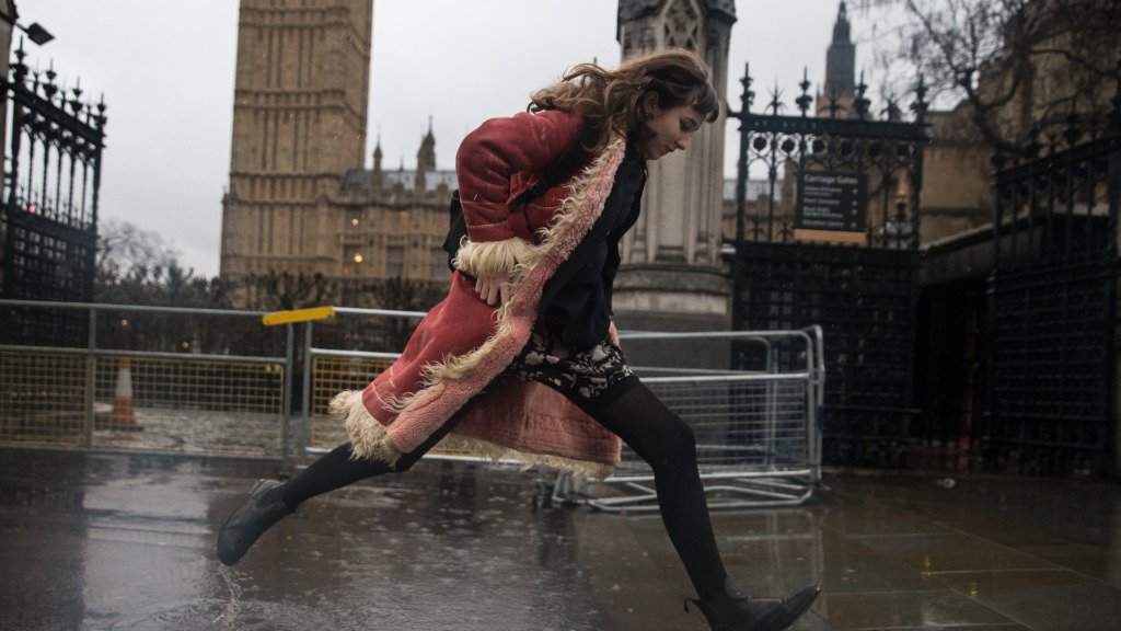 Wind, rain and snow outside the Houses of Parliament in central London. (AFP)