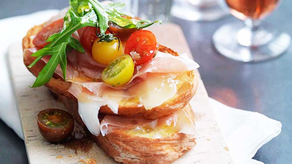 Next level toast recipes: Prosciutto, fontina, rocket and cherry tomato bruschetta recipe