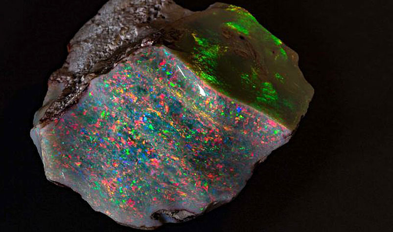 The 'Fire of Australia' opal was mined by Walter Bartram at Coober Pedy in 1946 and kept by his family ever since. (South Australian Museum)