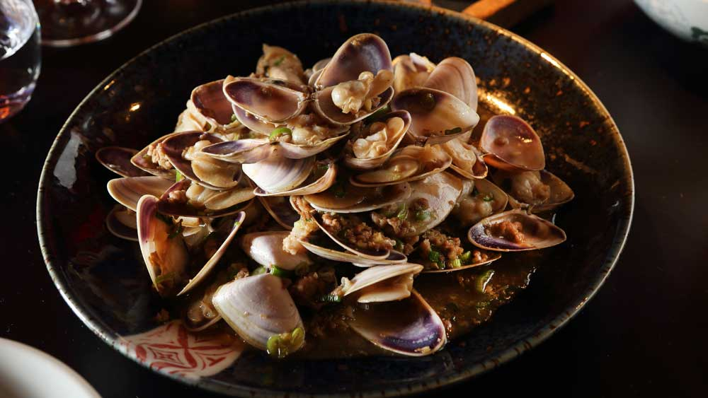 Spice Temple's pippies with pork and Shaoxing wine
