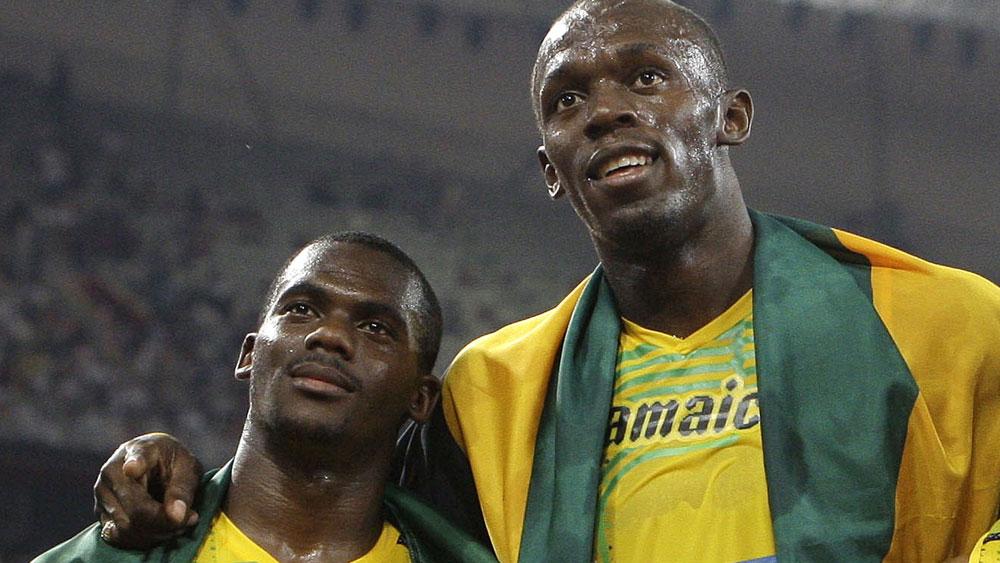 Nesta Carter and Usain Bolt. (AAP)