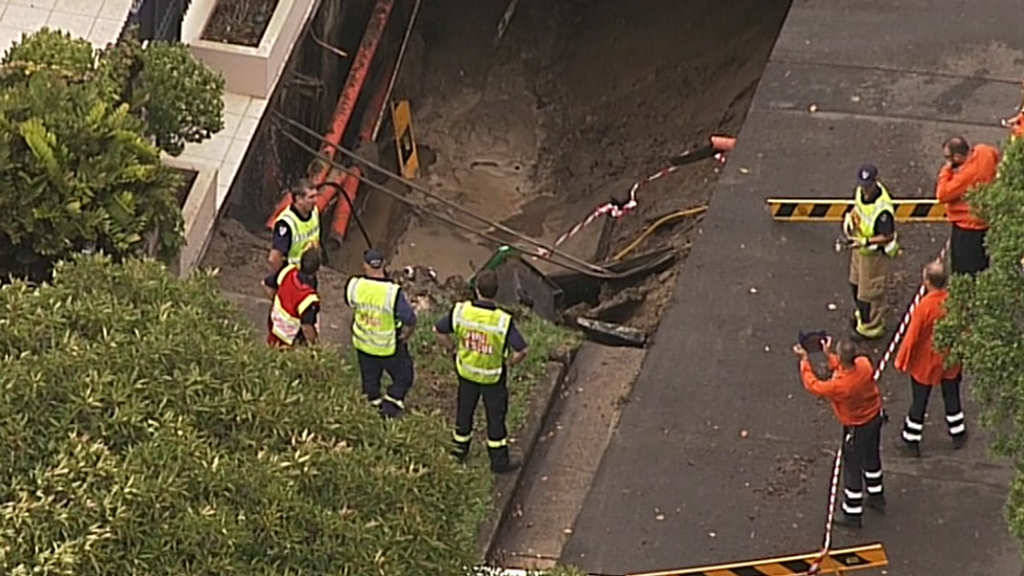 A street and footpath were closed as firefighters worked to stop the gas. (9NEWS)