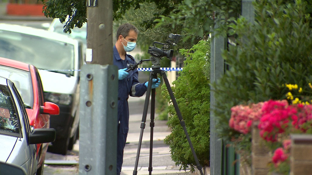 Police at the scene on Baxter Street. (9NEWS)