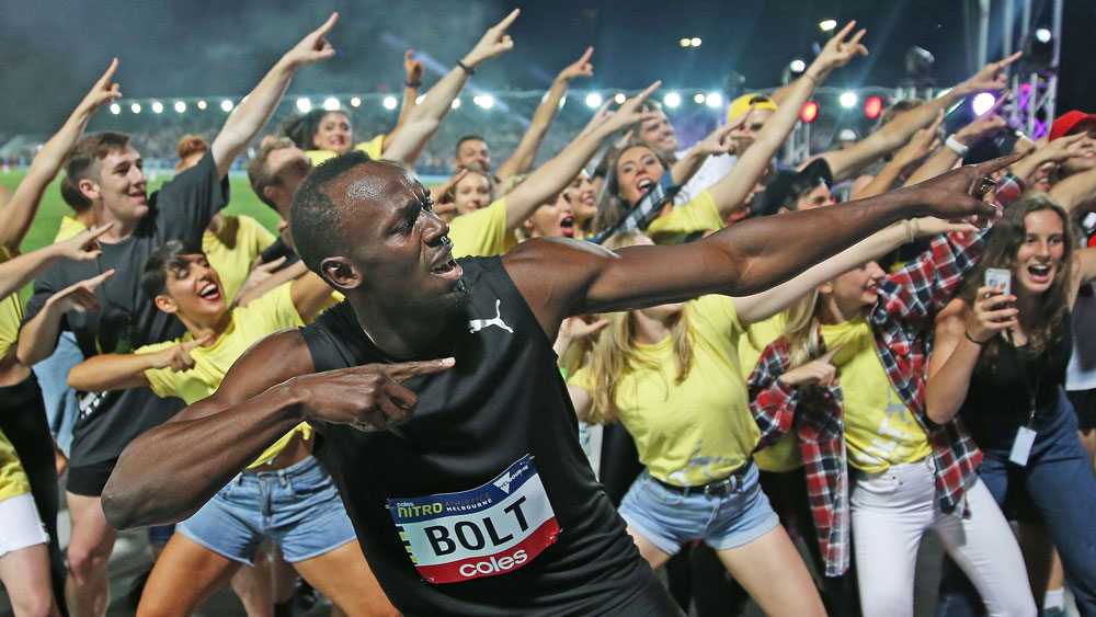 Bolt beats Aussies, belts out bad tune