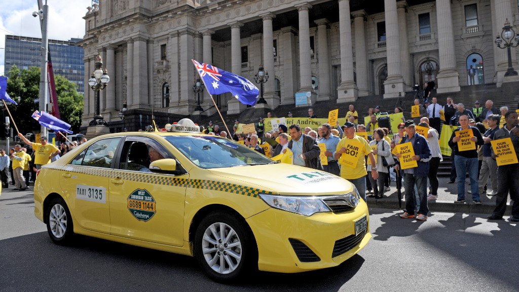 Yellow cabs and protesters in yellow t-shirts lined Spring Street. (AAP)