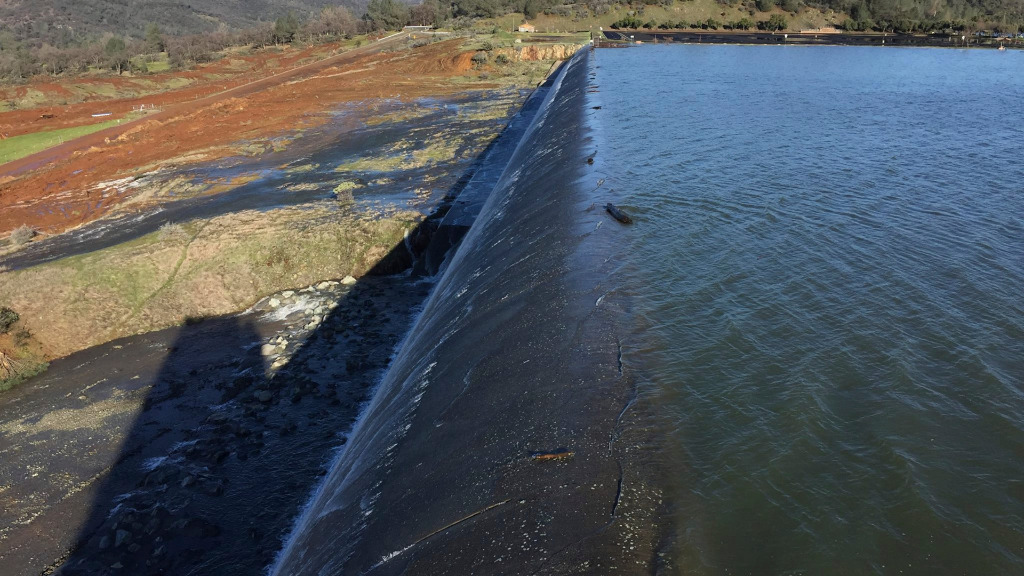 Officials said the dam will continue flow over the emergency spillway for at least another 38 hours. (AAP)