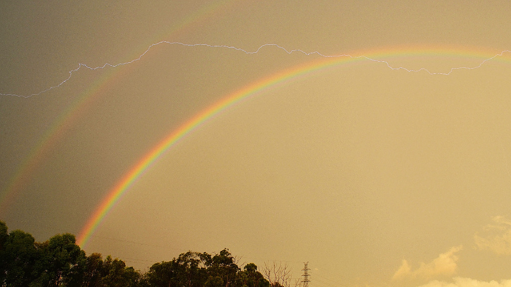 Lighting clashed with a double rainbow in Algester, Brisbane. (Dr Mahmood Nekooee)