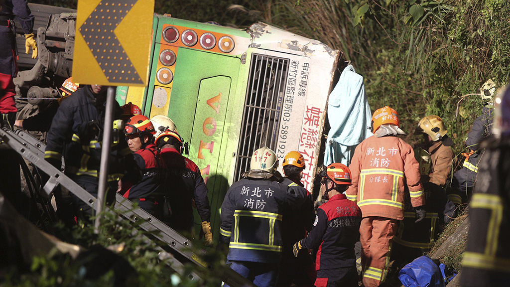 Victims' bodies were laid out at the crash site covered in white and blue cloths. (AAP)