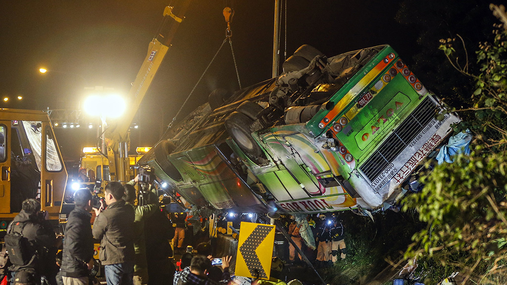 At least 32 dead in Taiwan's worst highway accident in decades